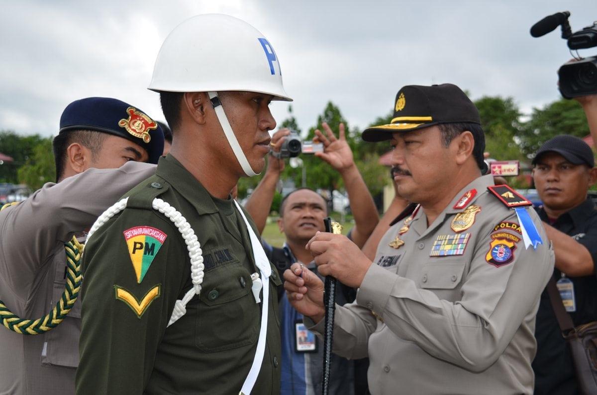Danrem 102/Pjg Hadiri Upacara Gelar Pasukan Pengamanan Natal dan Tahun Baru TA. 2014