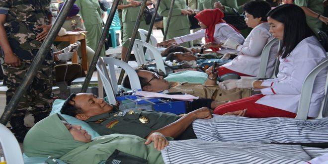 Prajurit Korem 044/Gapo Ikuti Bakti Sosial Hari Juang Kartika dan HUT Ke-53 Kowad