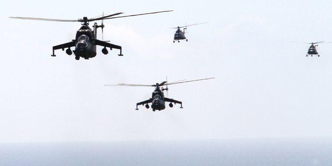 TNI AD MENURUNKAN 4 HELI UNTUK MENCARI AIRASIA