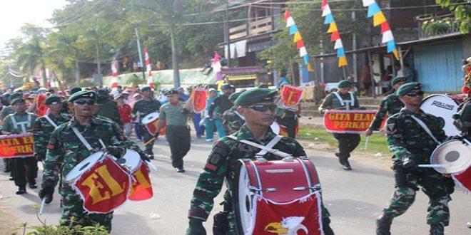 Aksi Drum Band Gita Elang Perkasa Yonif 752/VYS memeriahkan HUT Kabupaten Teluk Bintuni ke- 12.