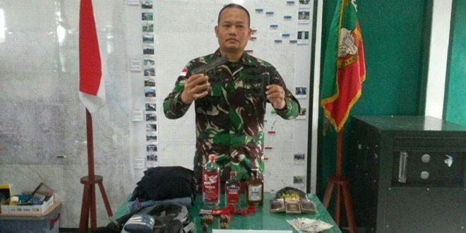 Kosektor Utara Satgas Pamtas RI-PNG Amankan Satu Pucuk Pistol dan Puluhan Butir Munisi
