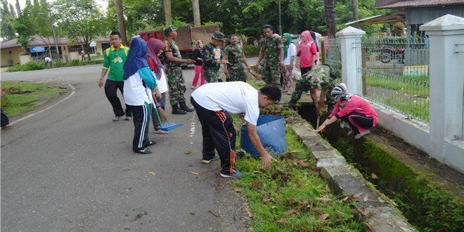 Kegiatan Karya Bhakti TNI Satkowil di Desa Koto