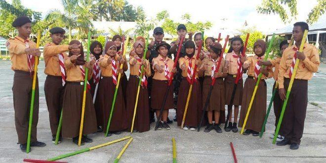 Yonif Mekanis 411 Kostrad Bina Gerakan Pramuka Madrasah Ibtidaiyah Koya Barat