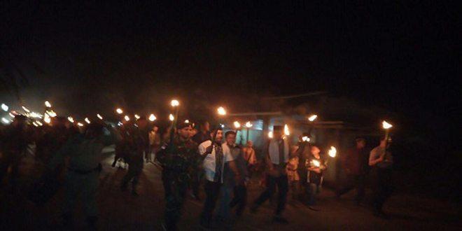 Takbir Keliling Satgas Pamtas RI-PNG Yonif Mekanis 413/Bremoro Kostrad Bersama Masyarakat Tanah Merah Boven Digoel