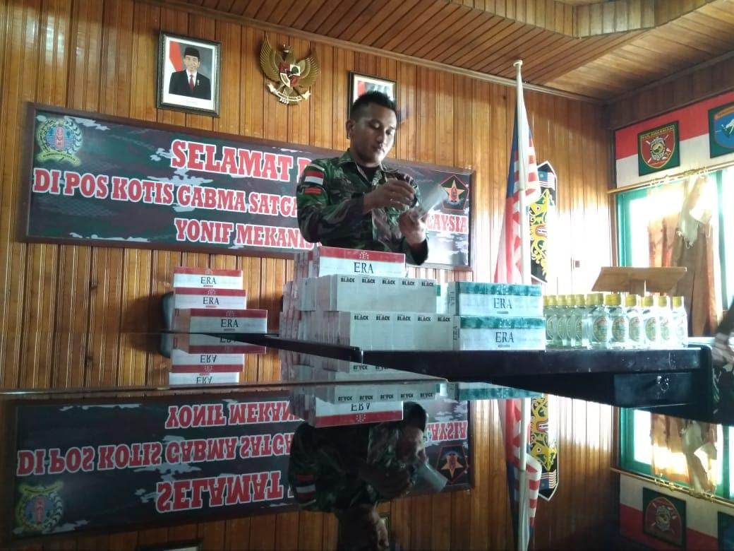 Ribuan Batang Rokok dan Miras Ilegal, Berhasil Digagalkan Satgas Yonif Mekanis 643 di Entikong