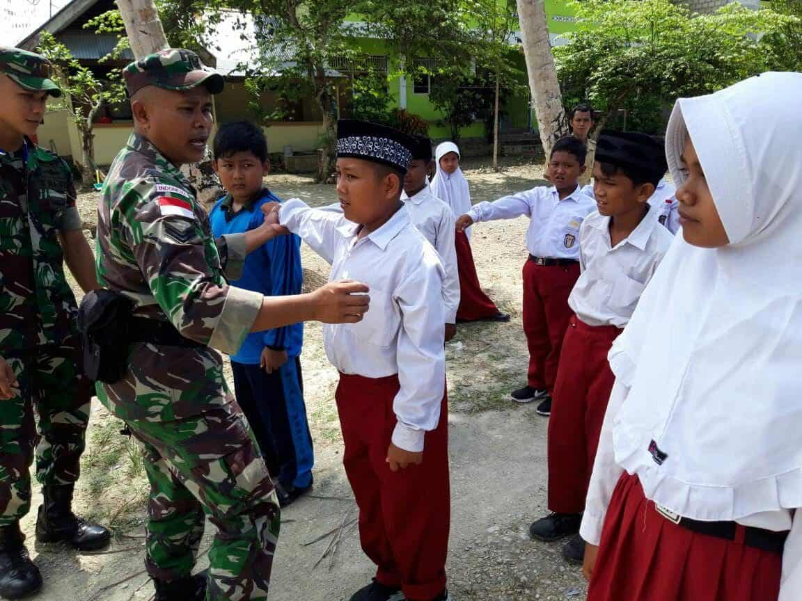 Siap Rayakan Hari Kemerdekaan Ri, Satgas Yonif Pr Latihkan Pbb Pelajar Di Arso