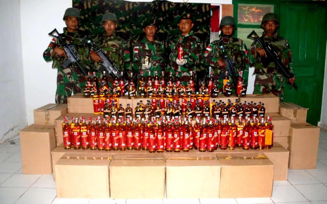 Satgas Yonif 411 Amankan Ribuan Botol Miras Ilegal