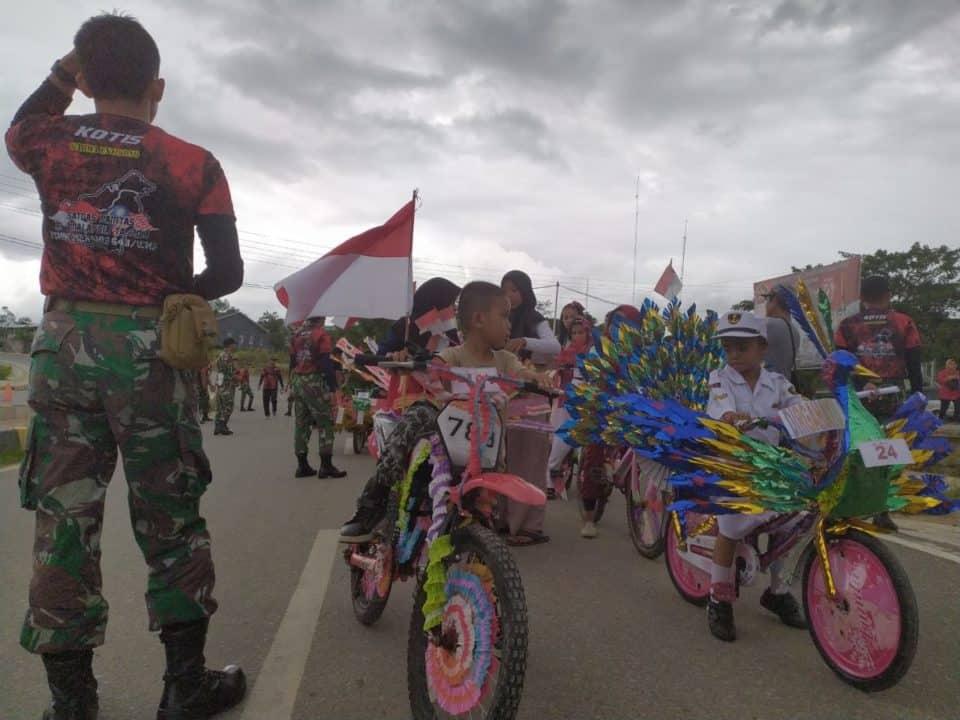 Meriahkan HUT TNI, Satgas Yonif 132 Gelar Lomba Anak dan Pengobatan Massa di Eban