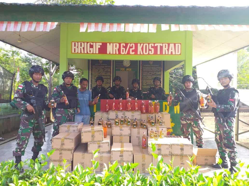 Ribuan Botol Miras Diamankan Satgas Yonif MR 411 di Trans Papua