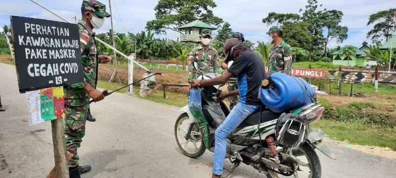 Lindungi Warga Dari Corona di Papua, Satgas Yonif R 300 Lakukan Pembatasan Pergerakan Orang