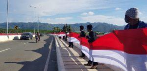 Bentangkan Bendera 1,5 Km di Jembatan Youtefa, Satukan Seluruh Elemen Masyarakat