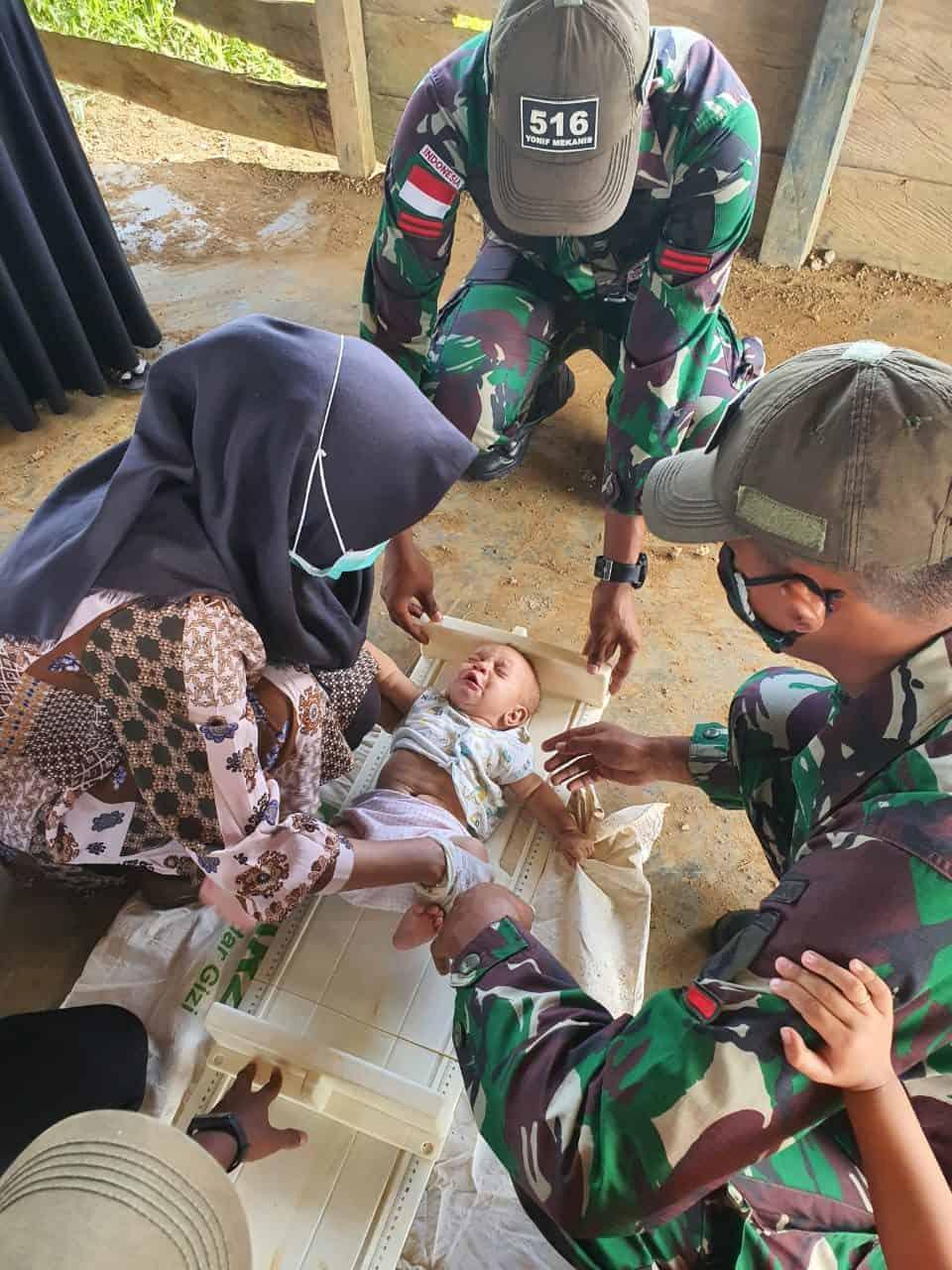 Satgas Pamtas RI-PNG Yonif Mekanis 516/CY Bersama Puskesmas Gelar Pelayanan Kesehatan