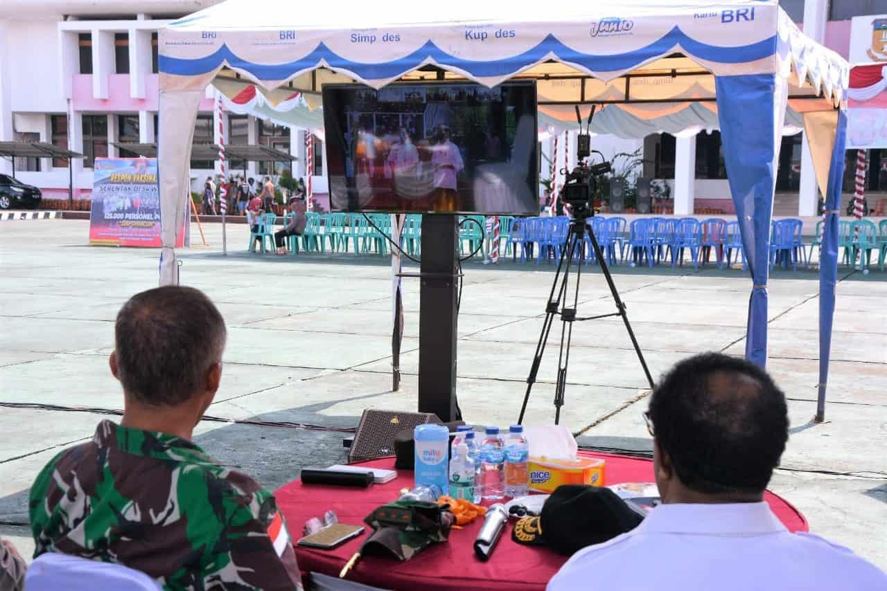 Pangdam XVII/Cenderawasih Hadiri Serbuan Vaksinasi Nasional dan Vicon Presiden RI dengan Jajaran TNI-Polri serta Kepala Daerah