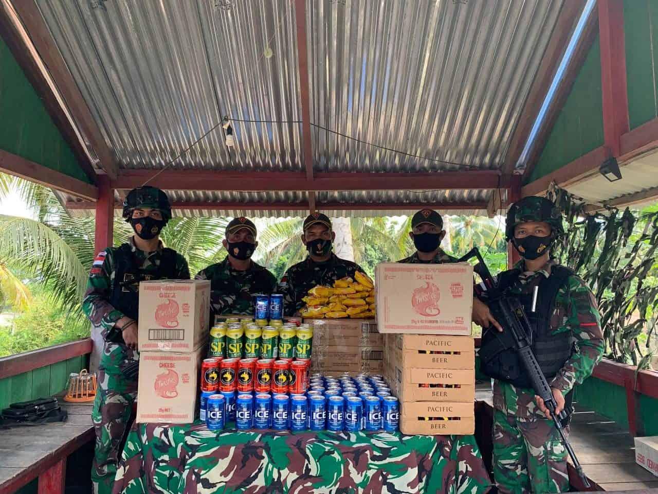TNI Satgas Pamtas Yonif 131/Brs Gagalkan Penyeludupan Ratusan Beer Kaleng Ilegal Dari PNG ke Papua