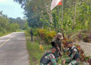 Sambut HUT RI Ke-76, Satgas Yonif 512/QY Bersama Masyarakat Kibarkan Merah Putih di Sepanjang Jalan Perbatasan