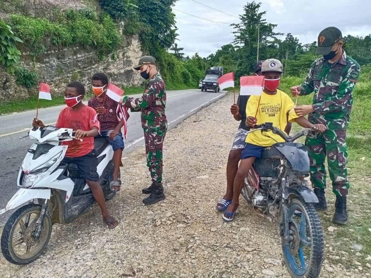 Semarakan HUT RI Ke 76, TNI Gelar Bakti Sosial dan Kibarkan Bendera Merah Putih Serentak di Papua