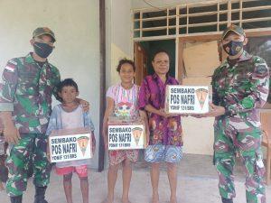 Satgas Yonif 131 Bagikan Sembako Kepada Masyarakat Kampung Nafri di Papua